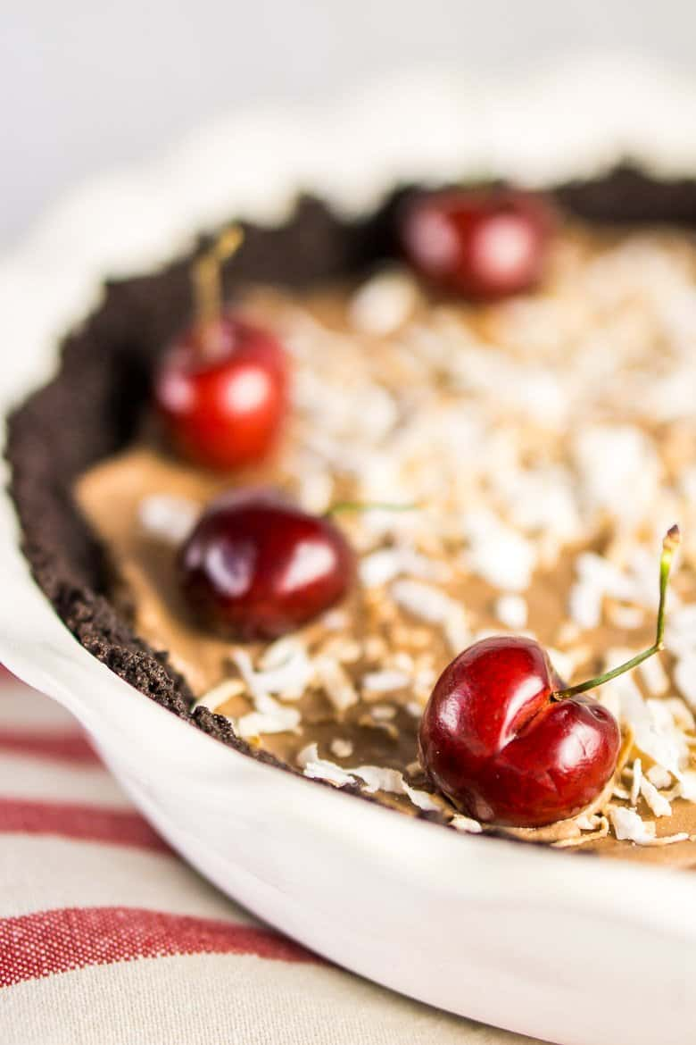 The frozen chocolate mousse pie on a red and white napkin.