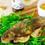 German pan-fried trout on a bed of parsley.