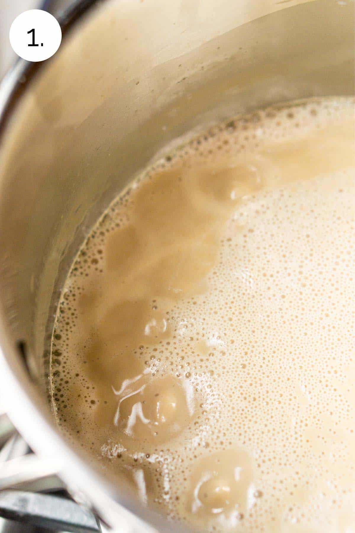 Simmering the heavy cream, milk and brown sugar in a medium saucepan.