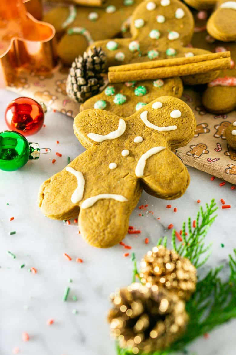 A gingerbread man cookie with Christmas decorations.