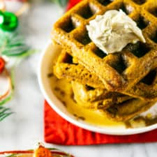 A stack of gingerbread waffles from the top down.