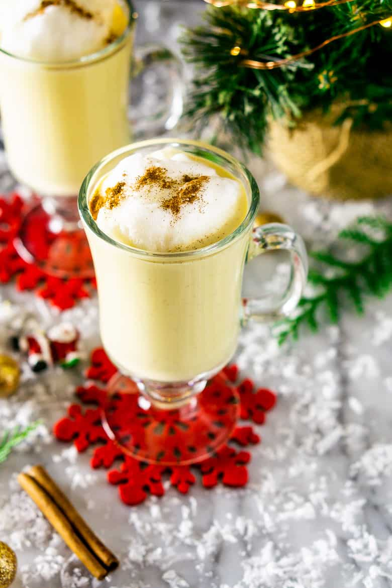 Over-the-top view of maple eggnog with Christmas decor.