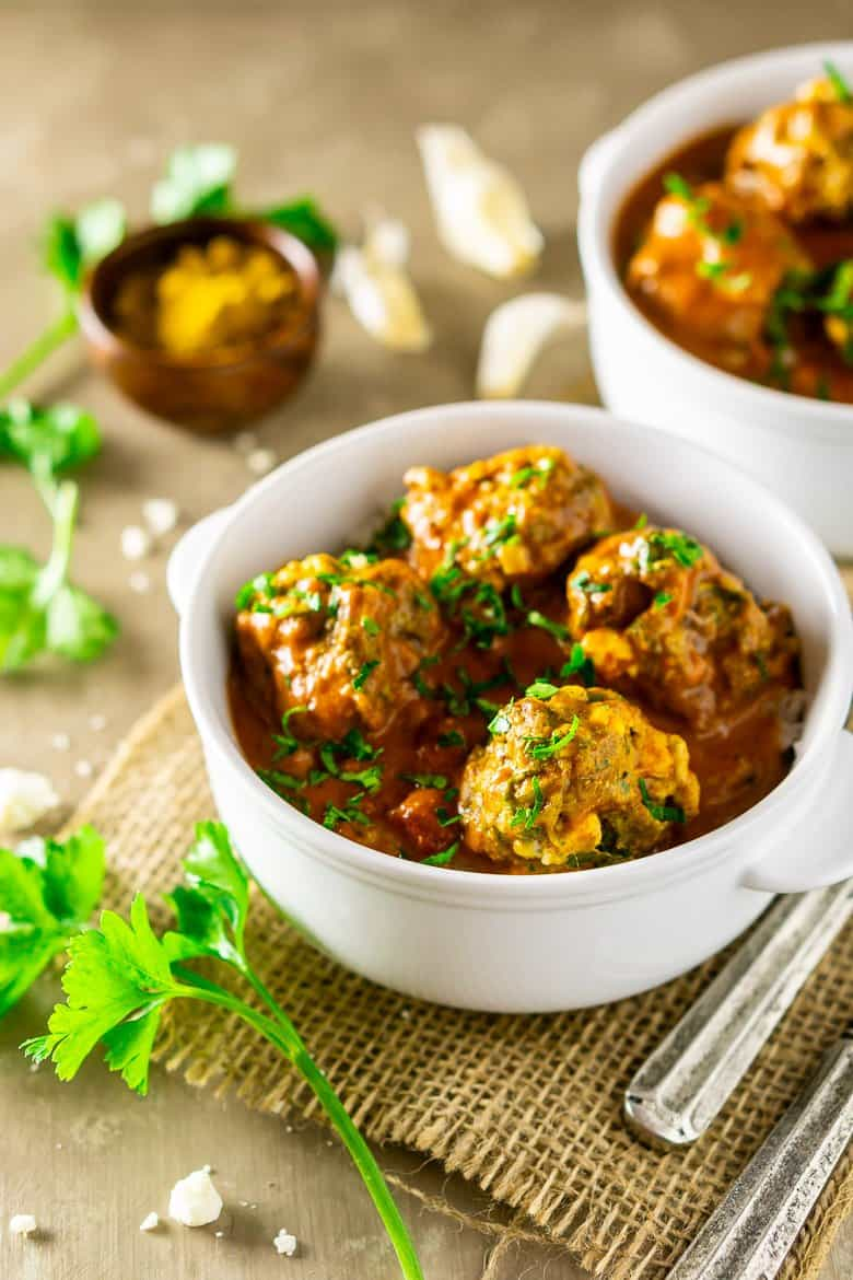 Two bowls of curried feta-lamb meatballs.