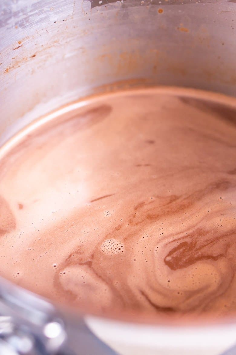 The cocoa powder whisked into the hot cocoa to make a smooth mixture.