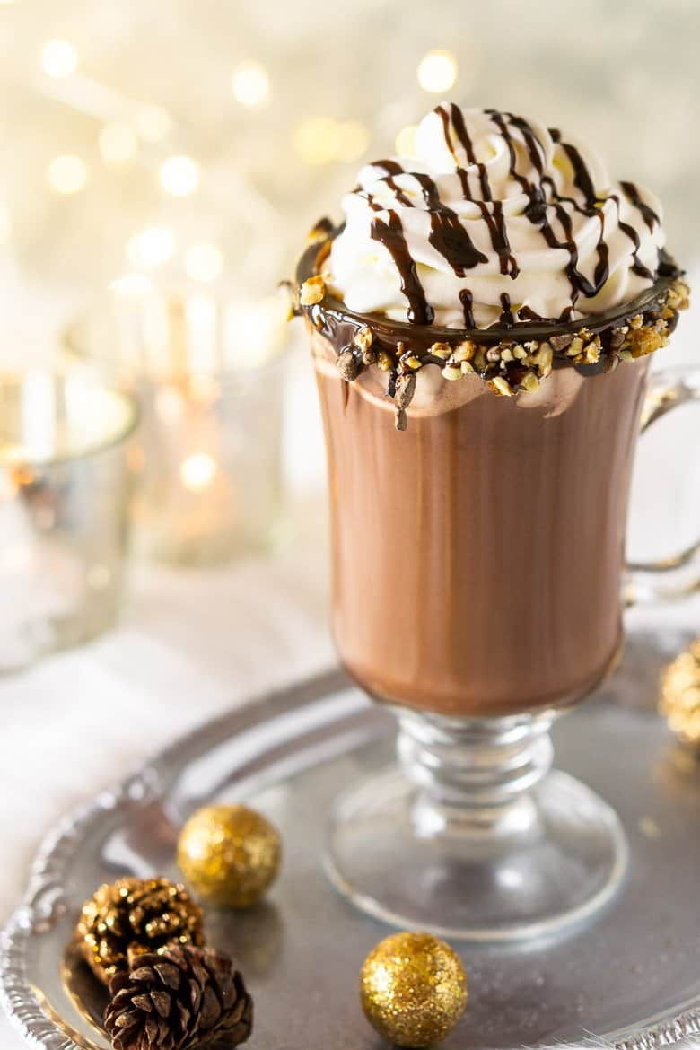 The homemade hot cocoa on a silver tray.
