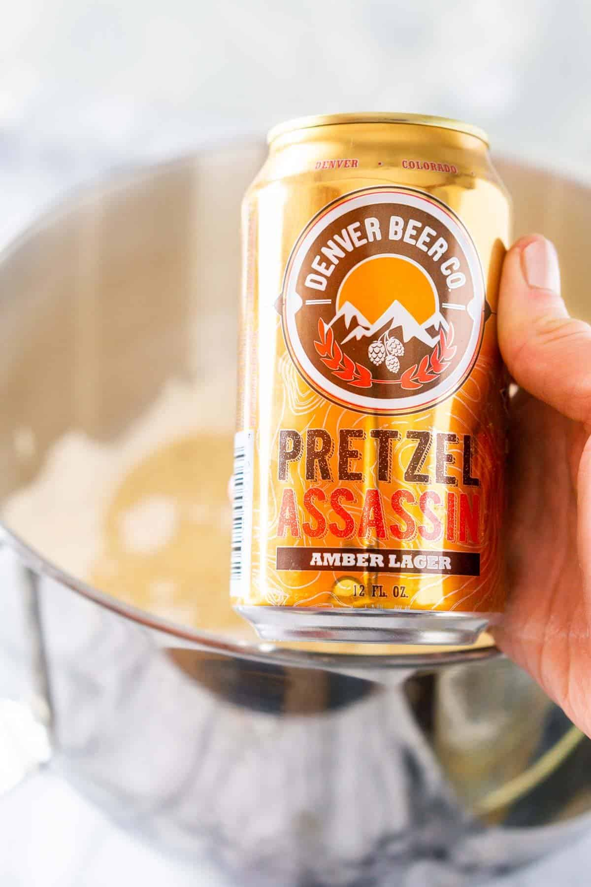 Showing some of the beer pizza dough ingredients for this recipe, including the beer used with the rest of the dough in the background.