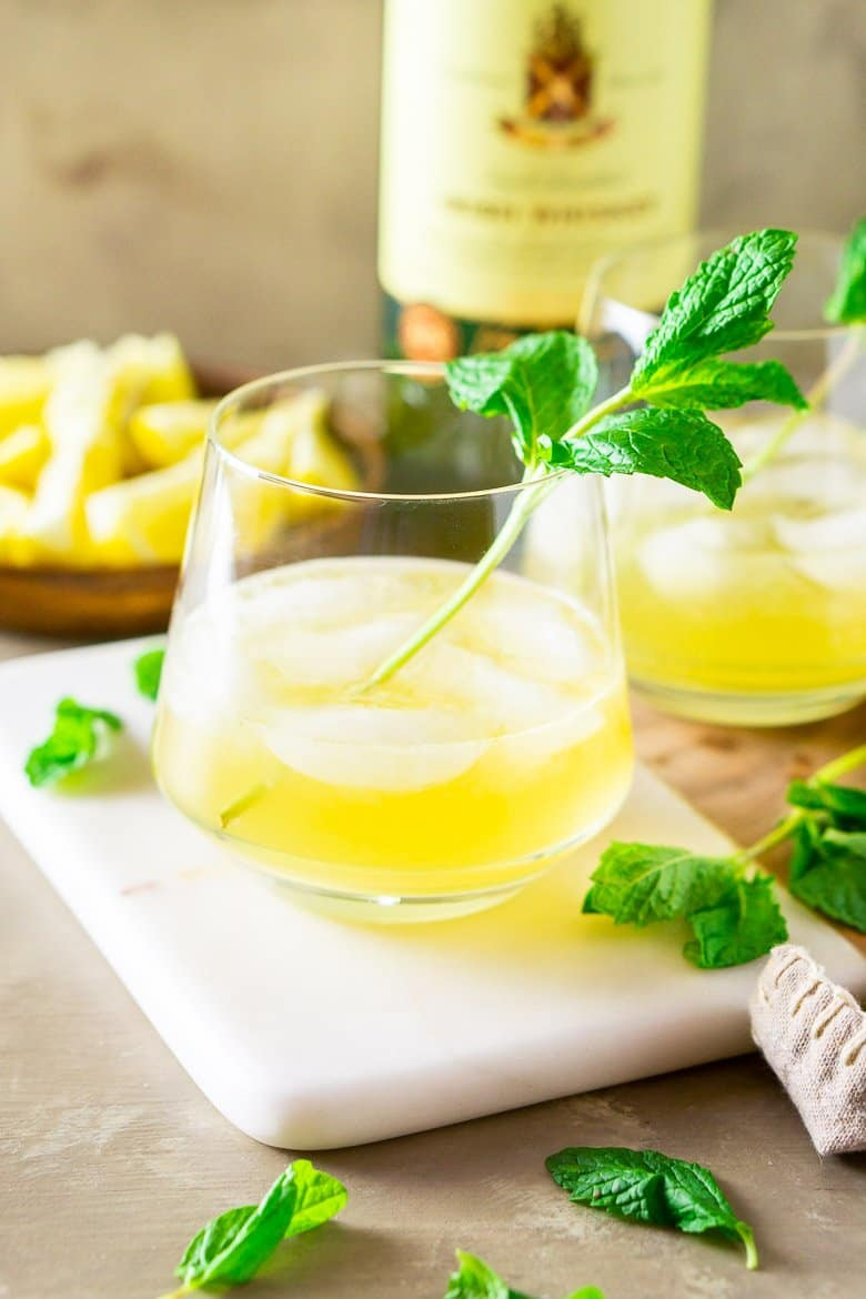 A closer view of an Irish whiskey smash with fresh mint and lemons.