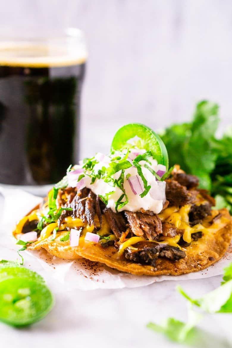 The beer-braised Mexican shredded beef on a tostada with a stout in the background.