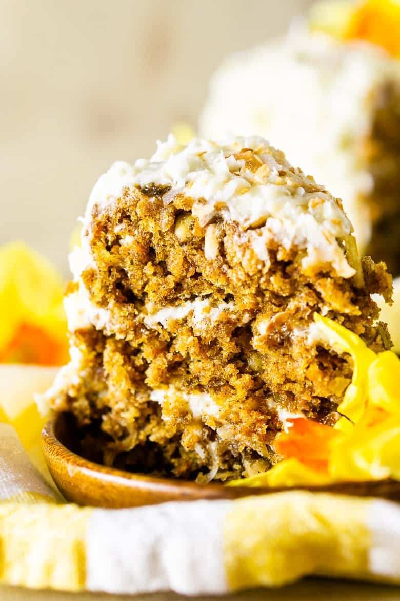 A closeup of the homemade carrot cake with coconut cream cheese frosting.