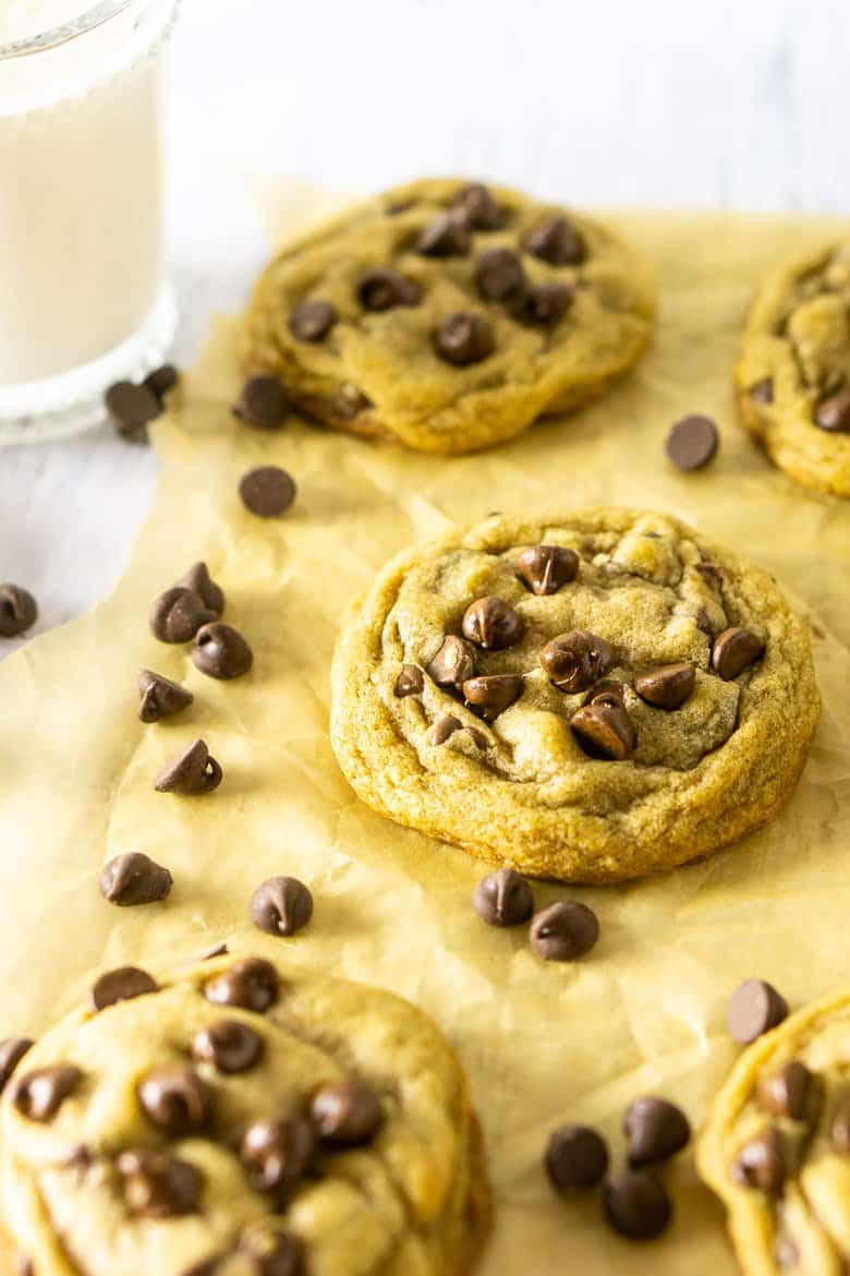 A brown butter chocolate chip cookies with a glass of milk.