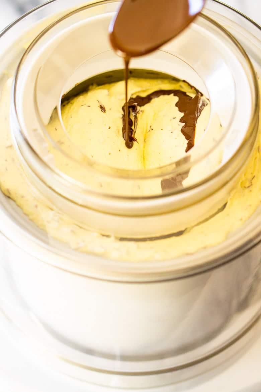 Pour chocolate into the custard base to make stracciatella ice cream.