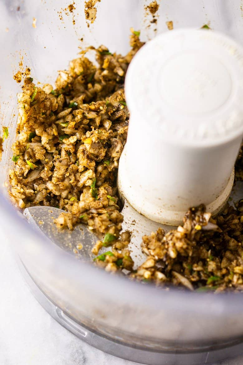 The Jamaican jerk sauce ingredients pulsed into a paste.