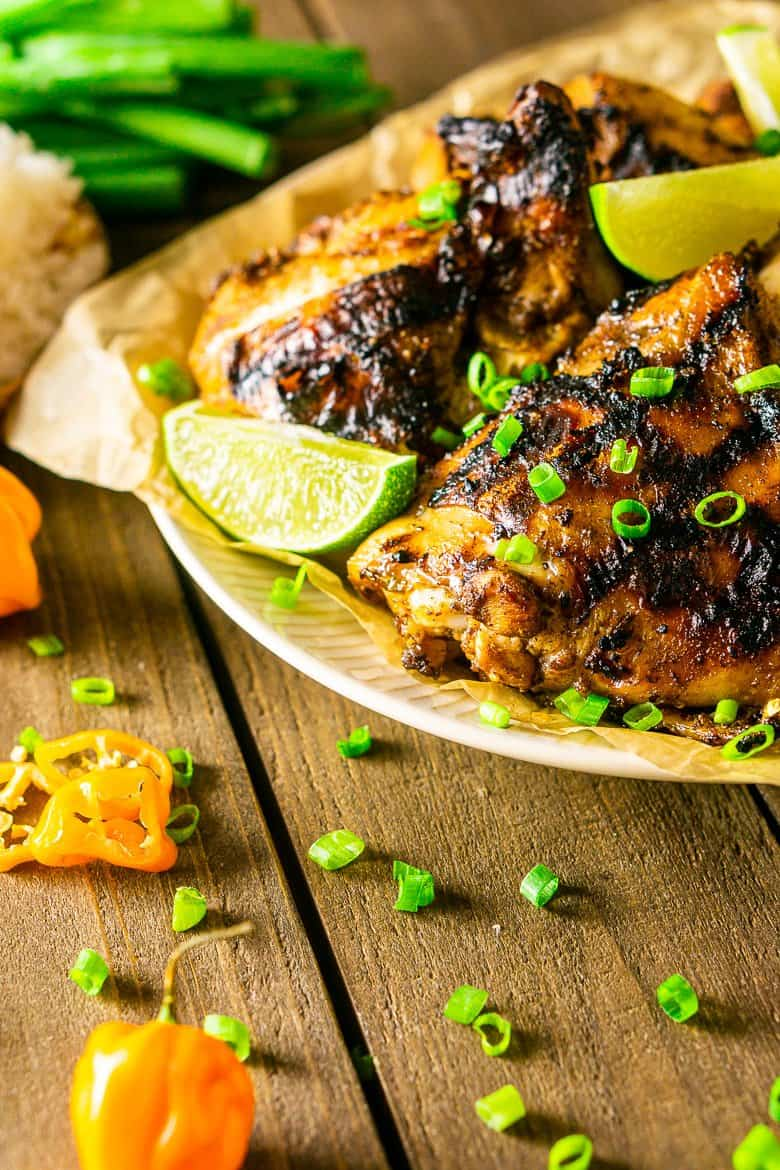 A plate of grilled Jamaican jerk chicken with rice.