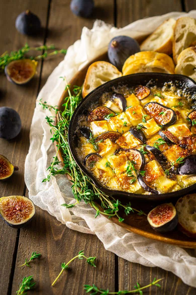 Looking down into a skillet of Baked Brie with fig and Kahlua sauce.