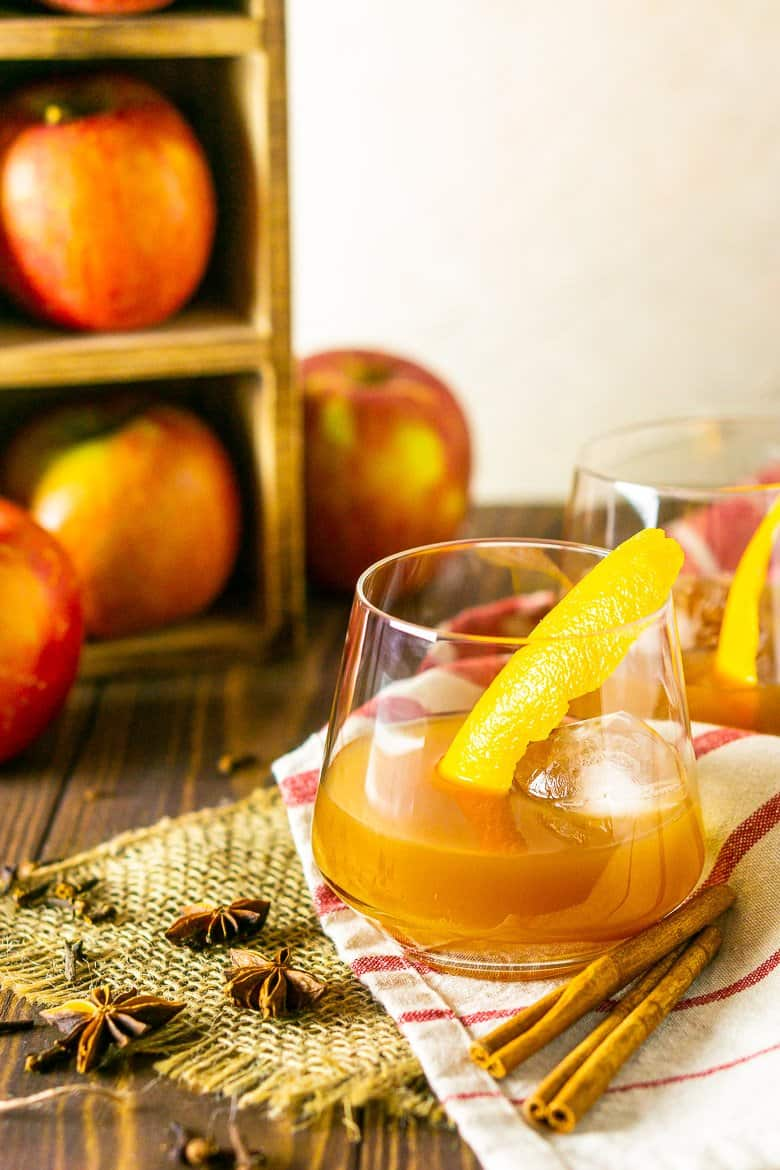An apple cider old fashioned with apples and spices.