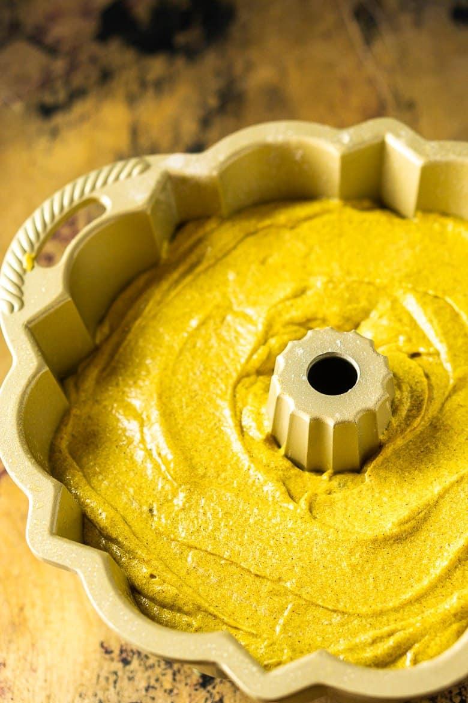 The buttermilk-pumpkin pound cake batter poured into a bundt pan.