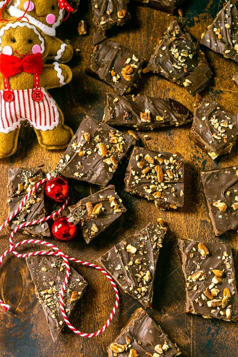 An aerial view of gingerbread toffee scattered on a wooden board.