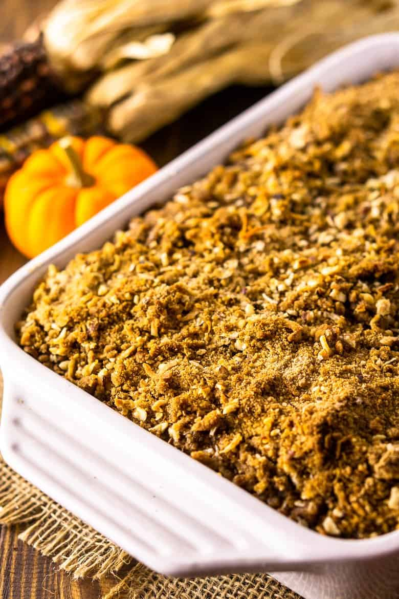 A baking dish of sweet potato souffle on burlap before it's been served.