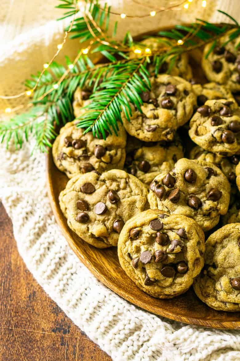 An aerial view of a plate of spiced holiday chocolate chip cookies.