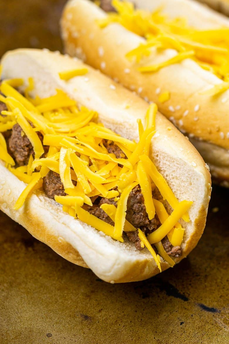 The buns filled with ground beef and cheddar before broiling.