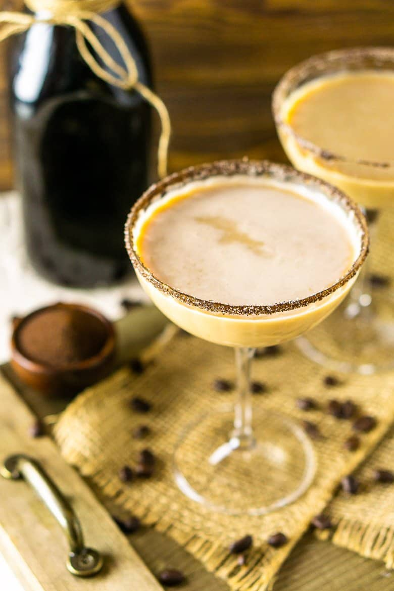 An aerial view of two coffee martinis with coffee beans and burlap.