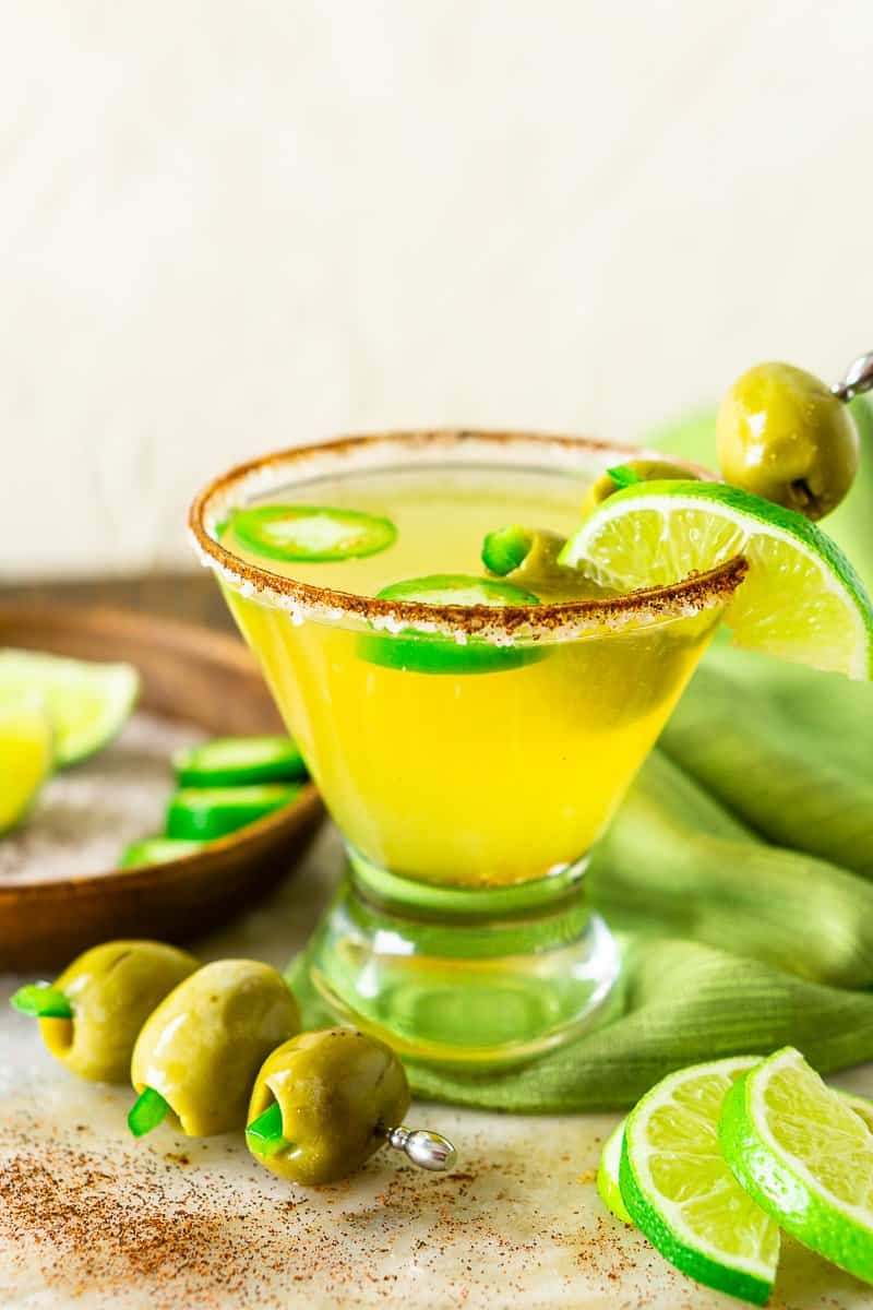 The spicy Mexican martini with a green napkin and olives.