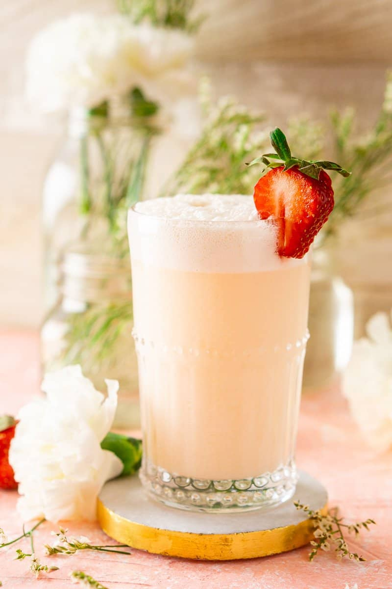 Looking at the strawberry-rhubarb gin fizz just off to the side with flowers.
