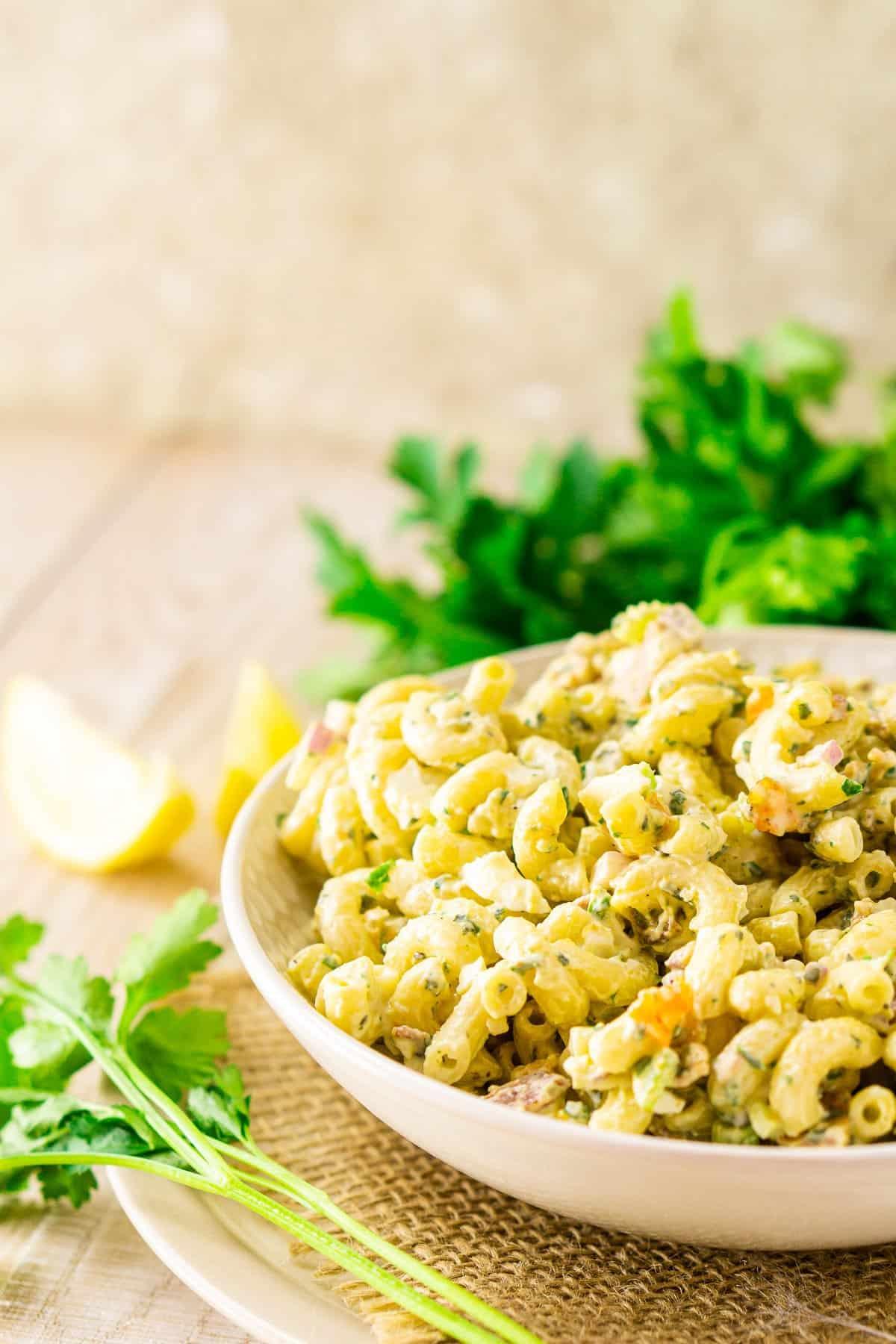 A bowl of macaroni salad on burlap.