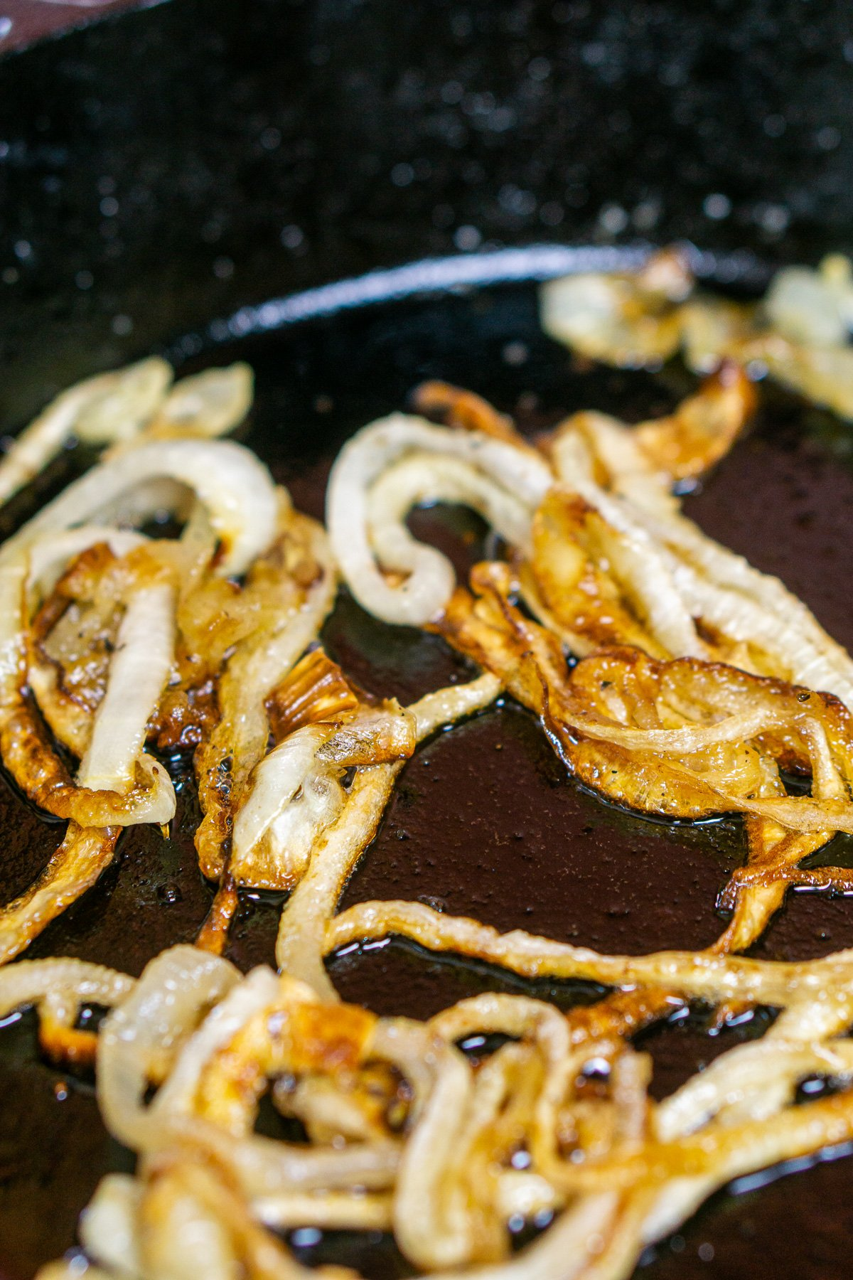 The caramelized onions in a cast-iron skillet after cooking.