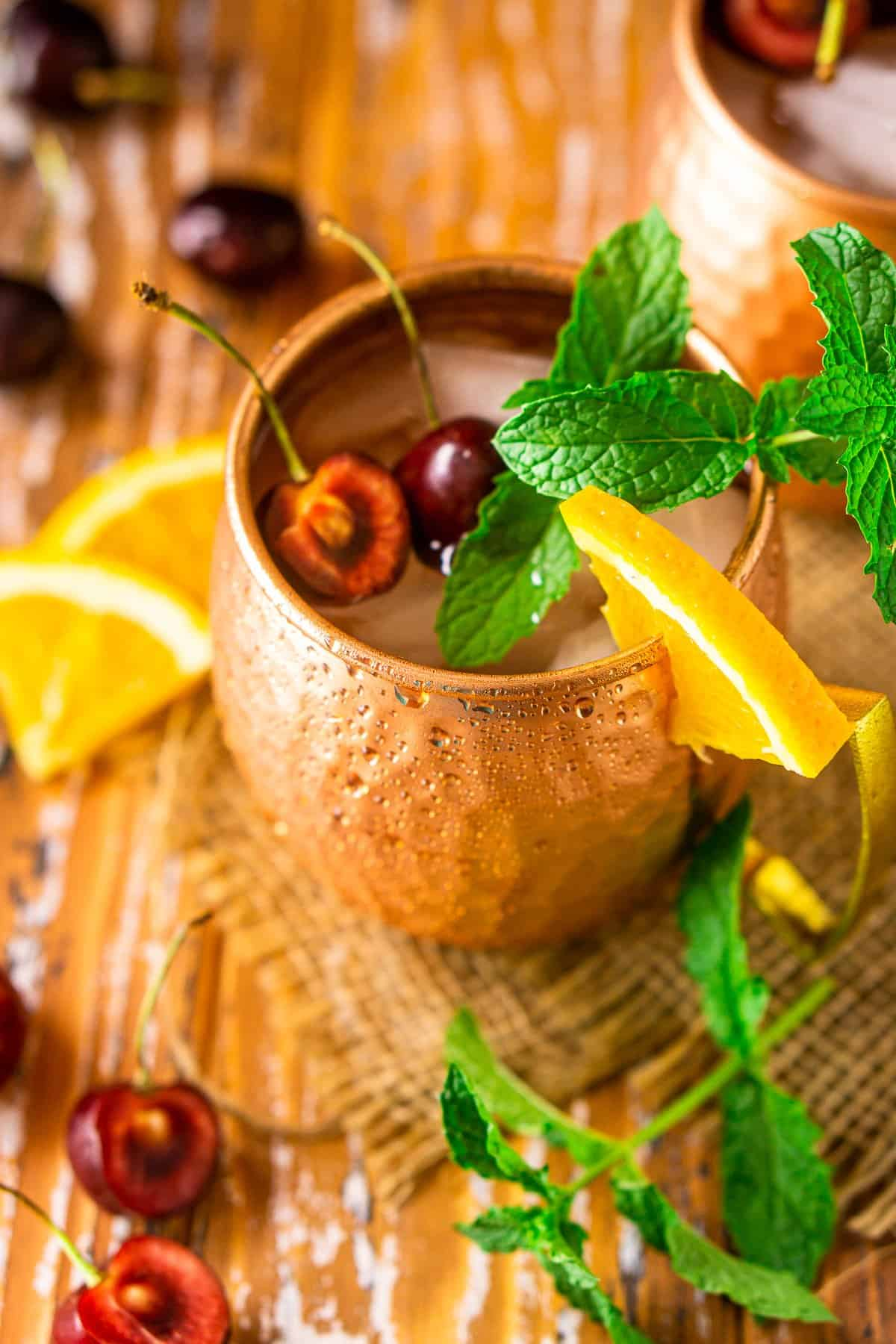 An aerial view of the Kentucky mule with cherry, orange and mint garnishes.