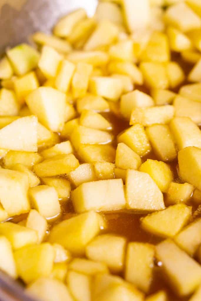 The diced apples after they've softened in a skillet with maple syrup and butter.