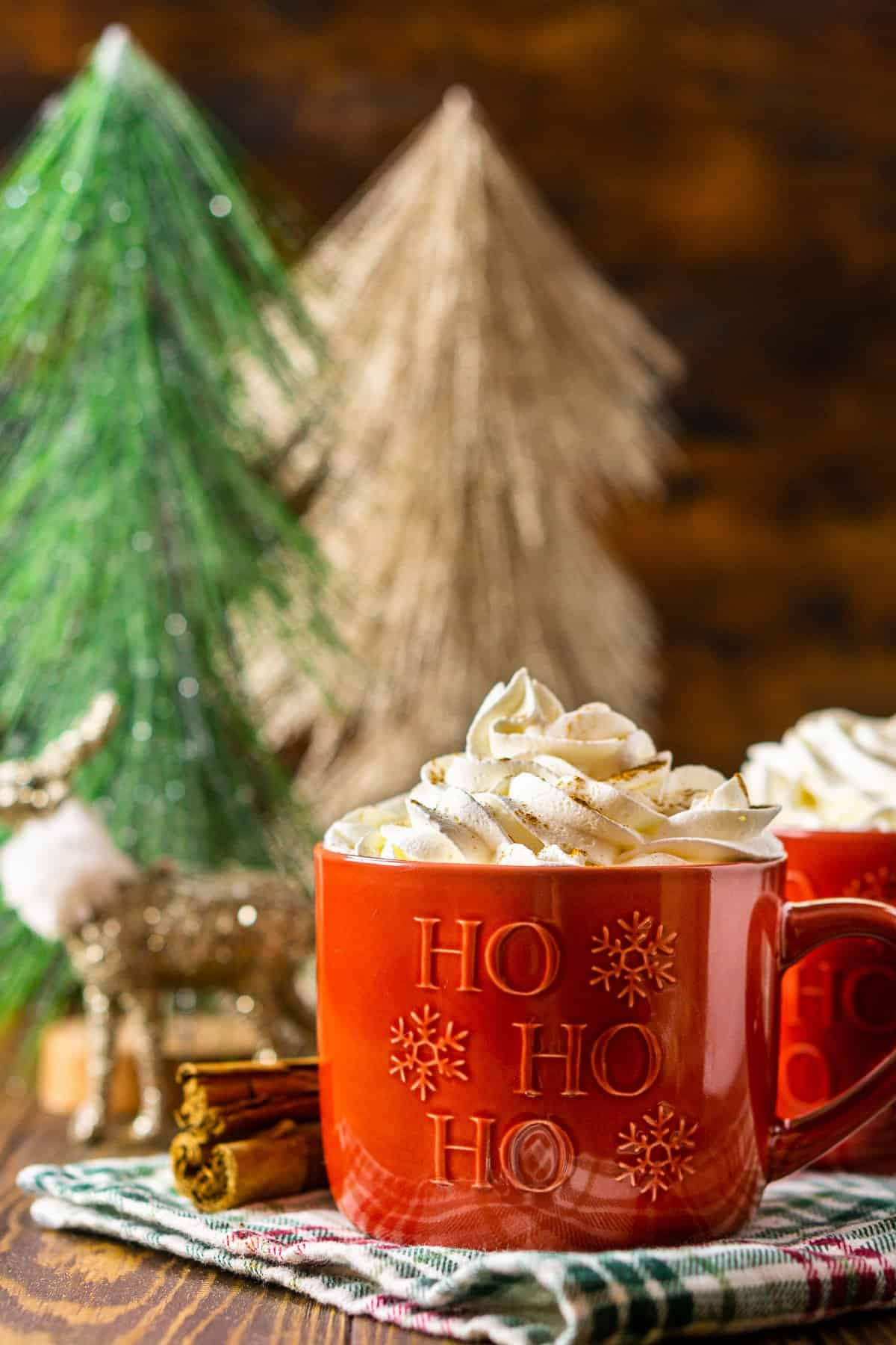A straight-on shot of the gingerbread latte on a festive towel.