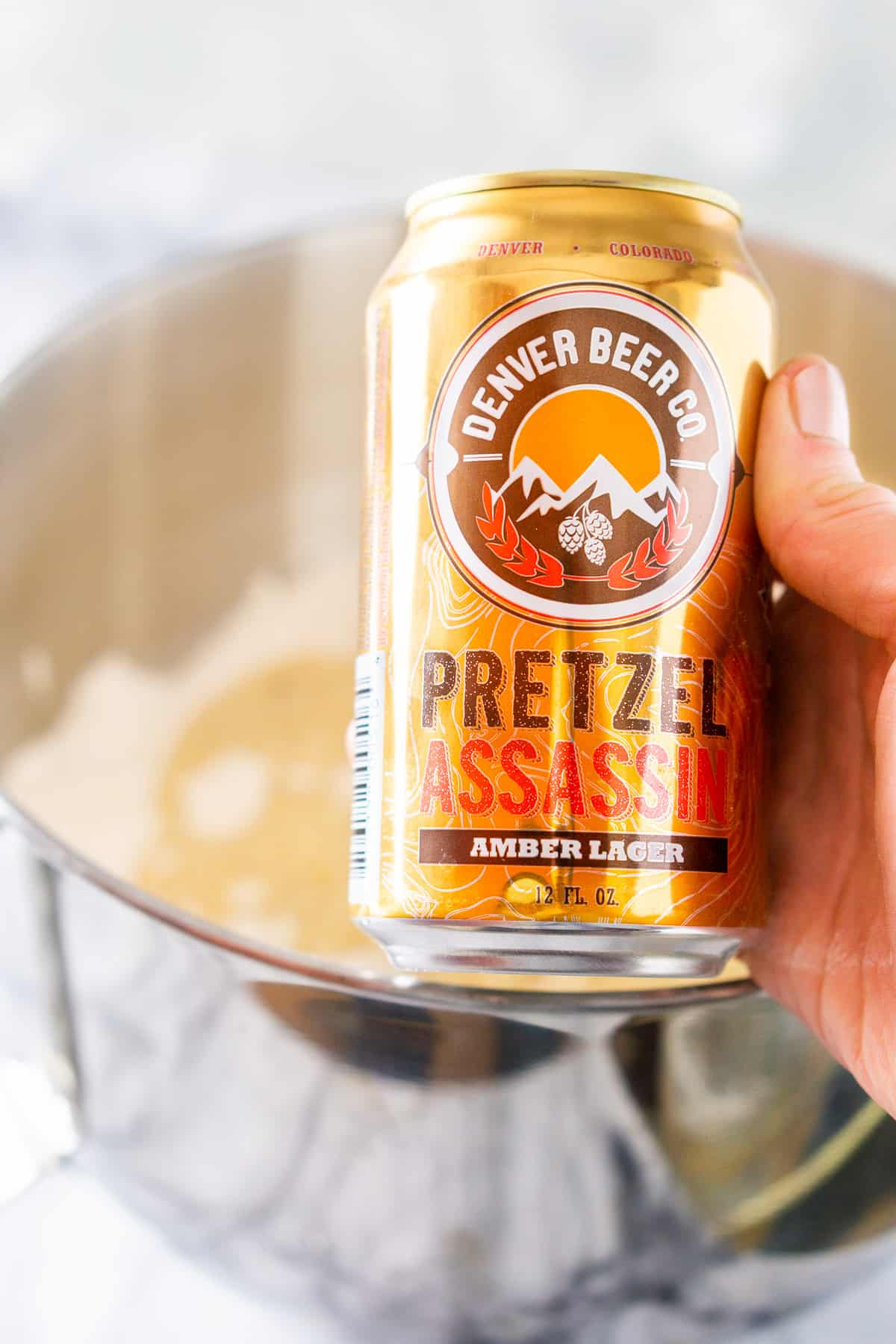 Showing some of the ingredients for this recipe, including the beer used with the rest of the dough in the background.