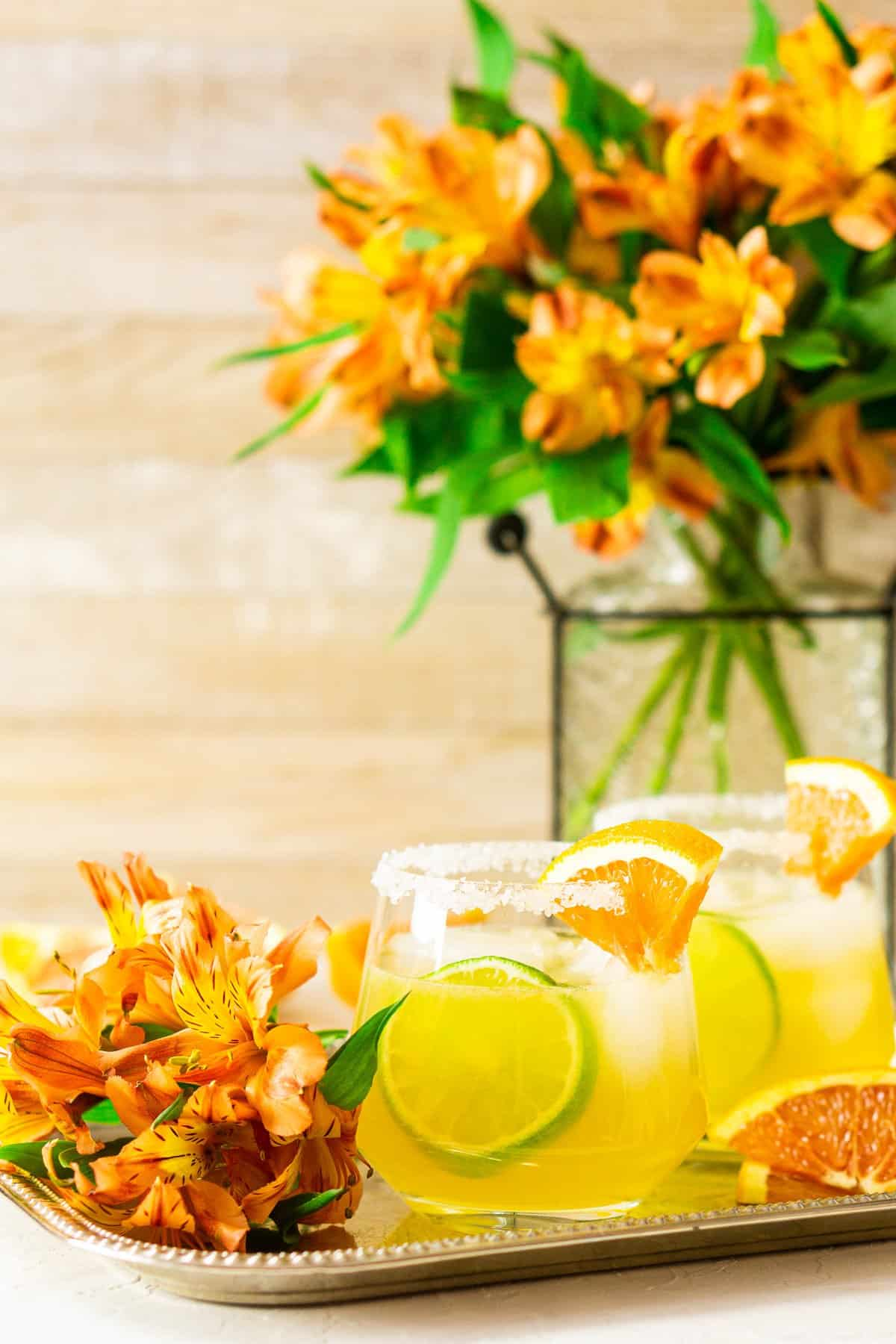 Looking straight onto a Cara Cara margarita with flowers in the background and to the side.