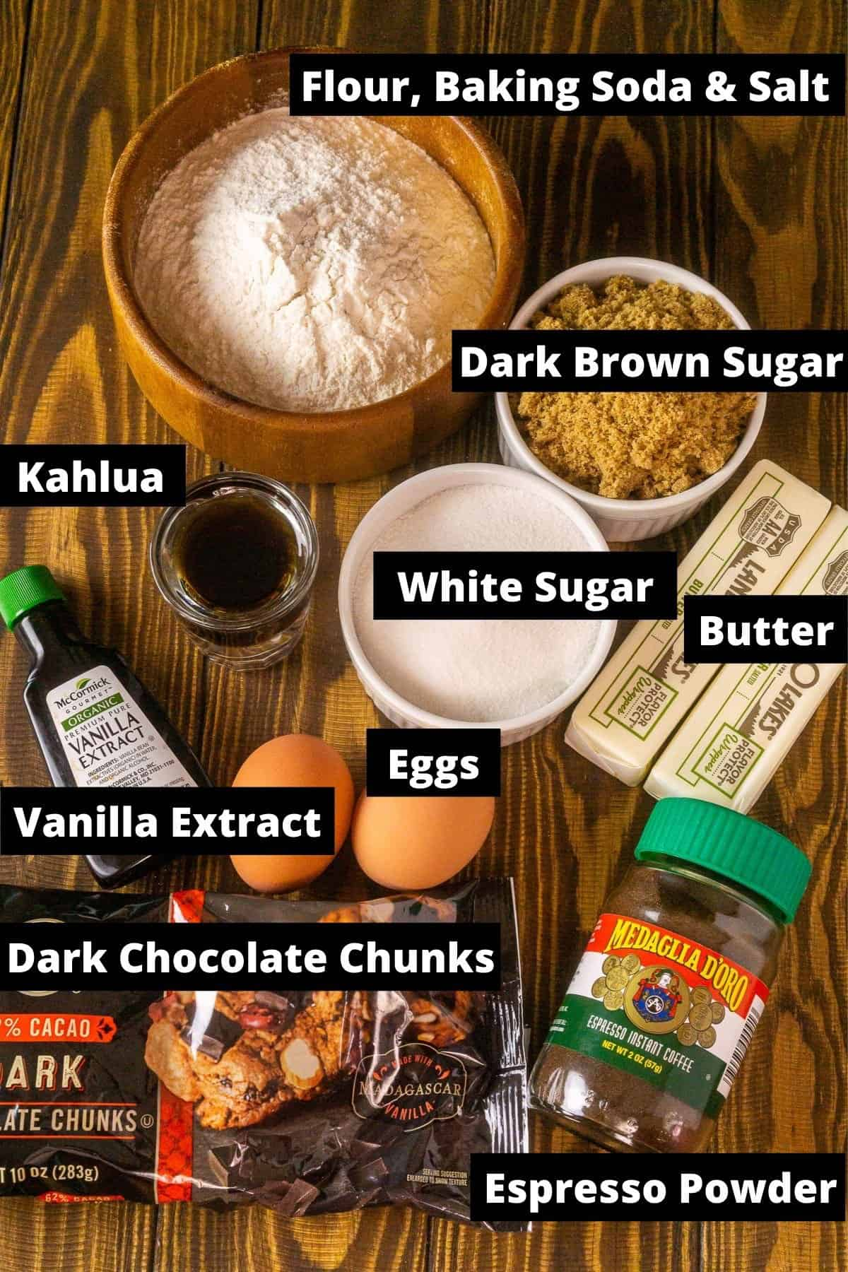 The ingredients for the Kahlua cookies on a wooden background with black and white labels.