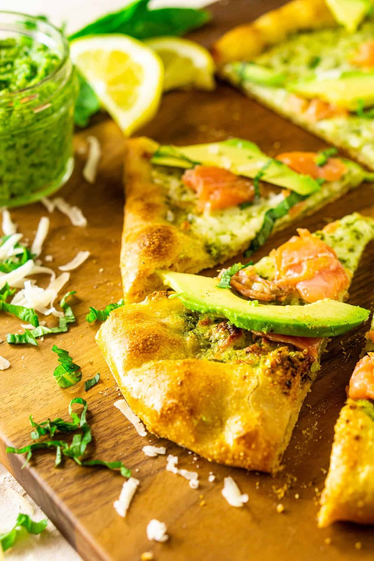 The smoked salmon and avocado pizza with pesto after it's been sliced.