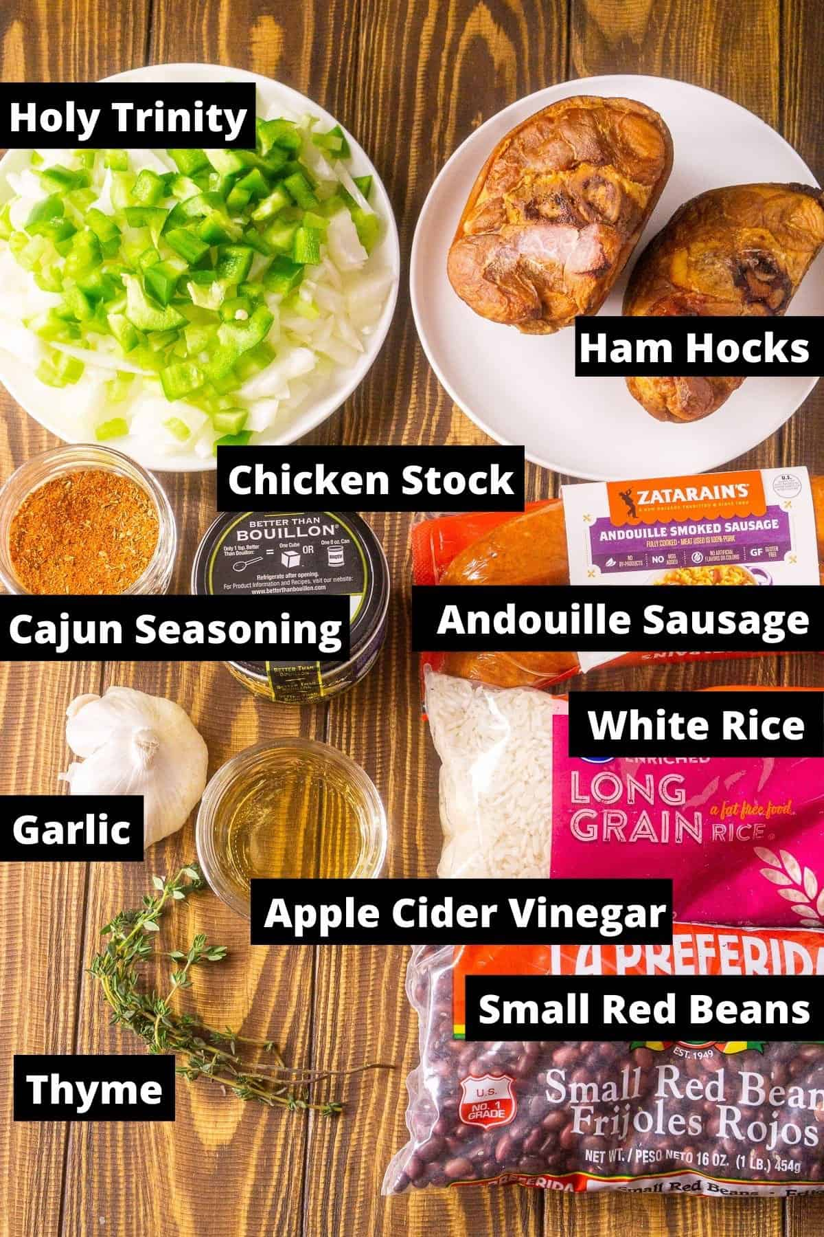 The Instant Pot red beans and rice ingredients with black and white labels on a wooden board.