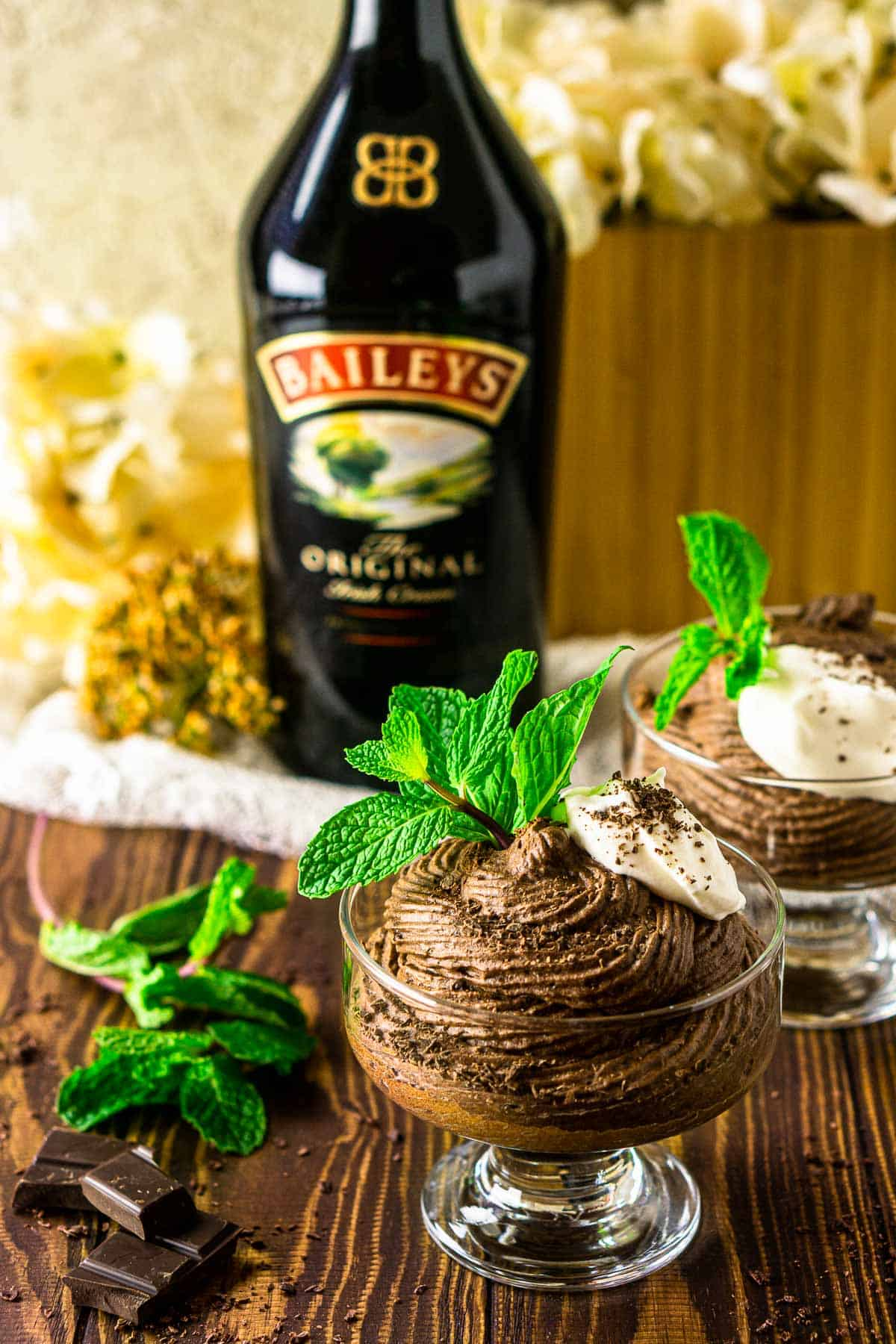 Looking down on the Baileys chocolate mousse with a bottle of Irish cream behind it.