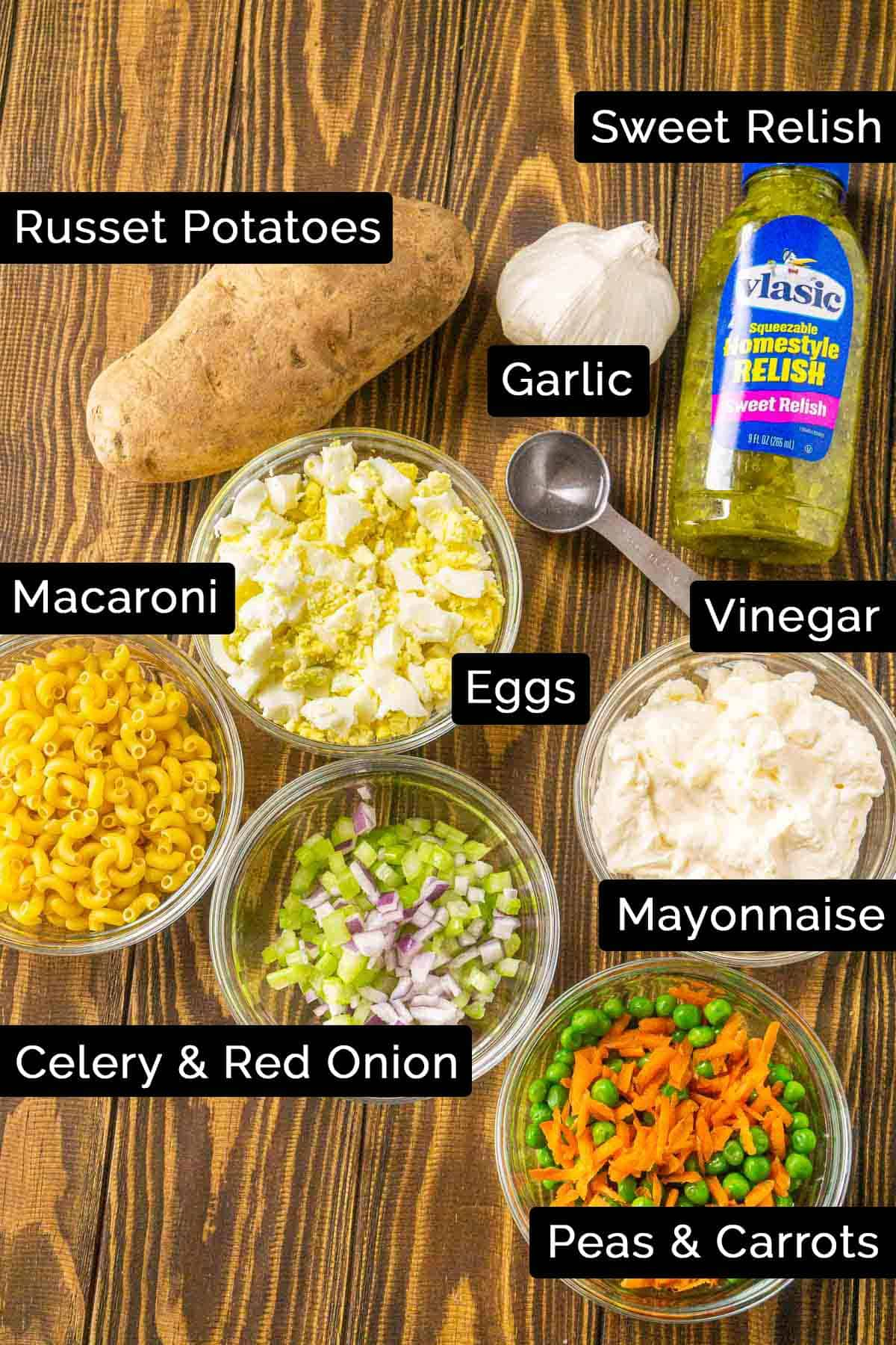 The Hawaii potato salad ingredients with labels on a wooden board.