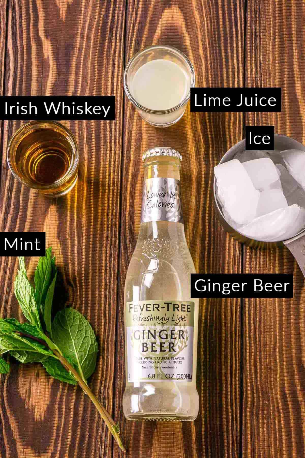 The Irish mule ingredients on a wooden board with black and white labels.
