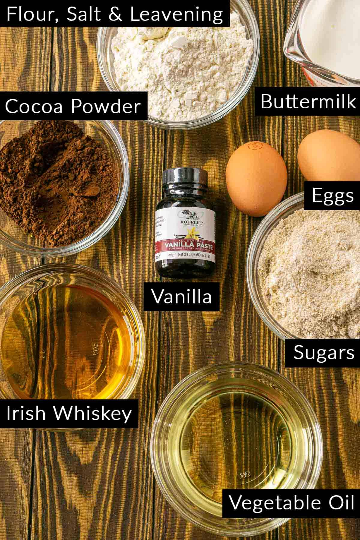 The Irish whiskey chocolate cake ingredients with labels on a wooden board.