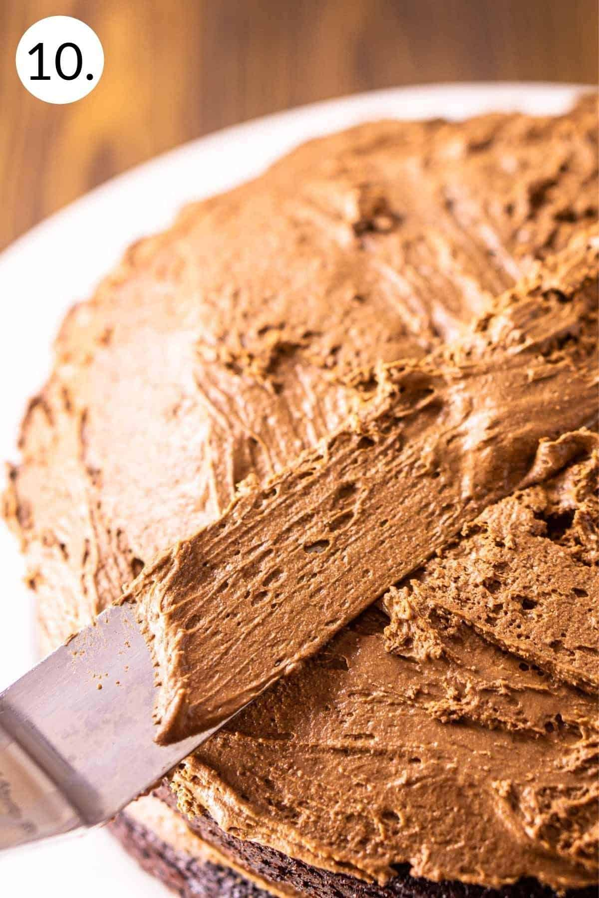 Spreading the Baileys mousse in between the layers of cake.