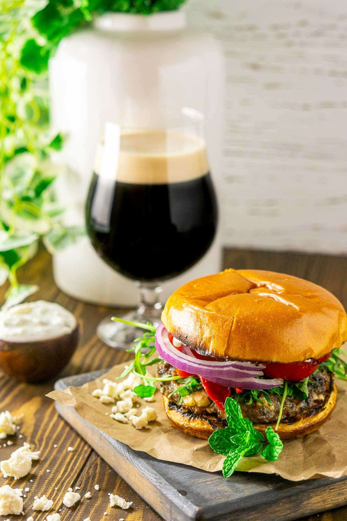Looking down on a minted lamb burger with the beer to the side.