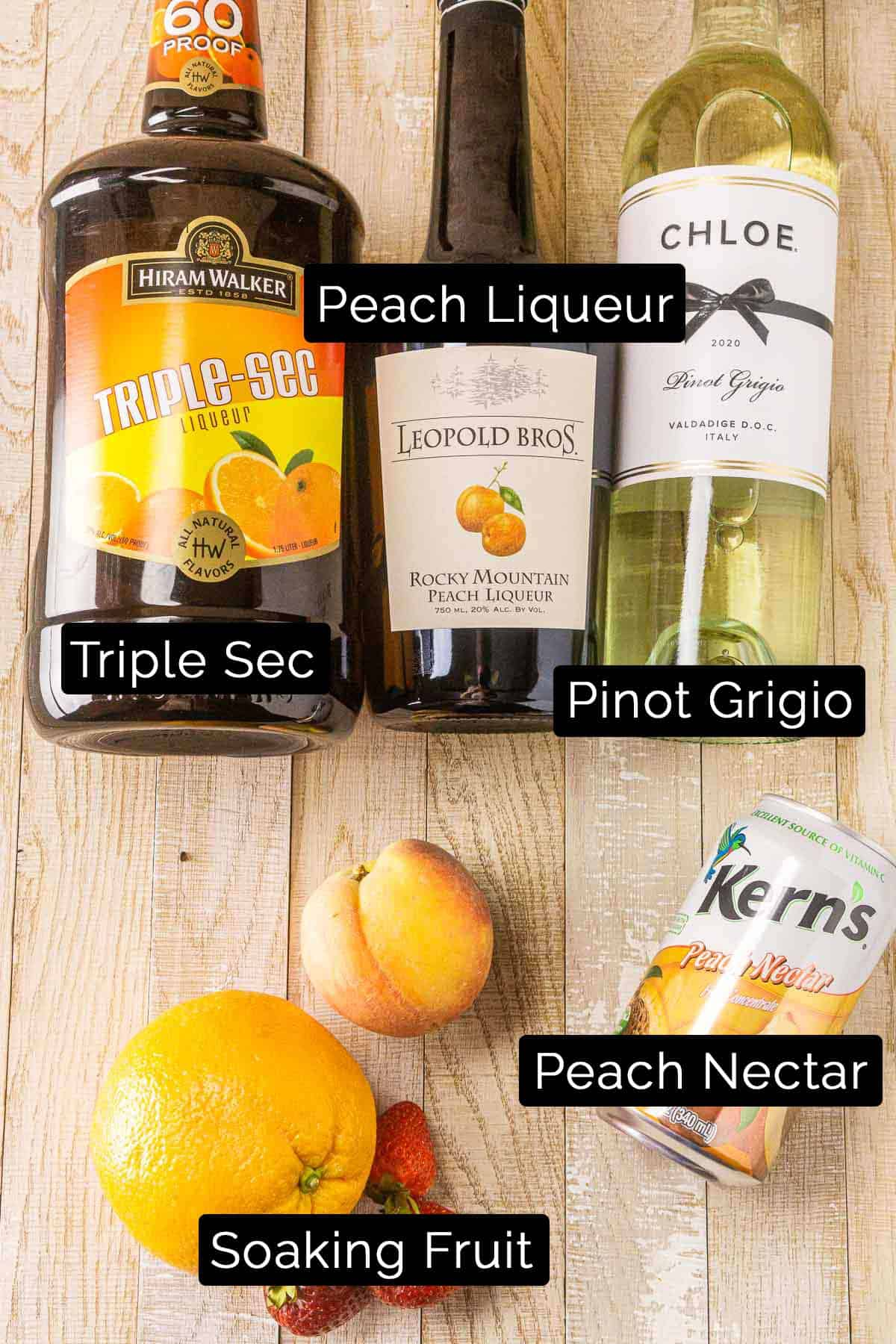 The peach sangria ingredients with black and white labels.
