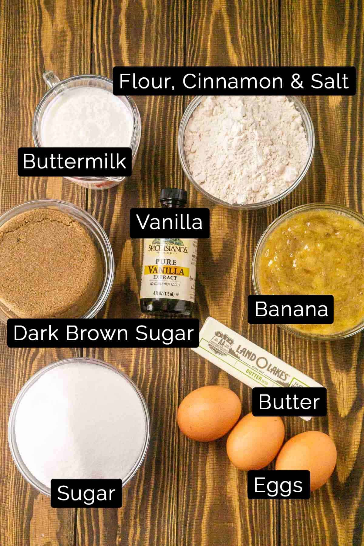 The ingredients with black and white labels on a wooden background.