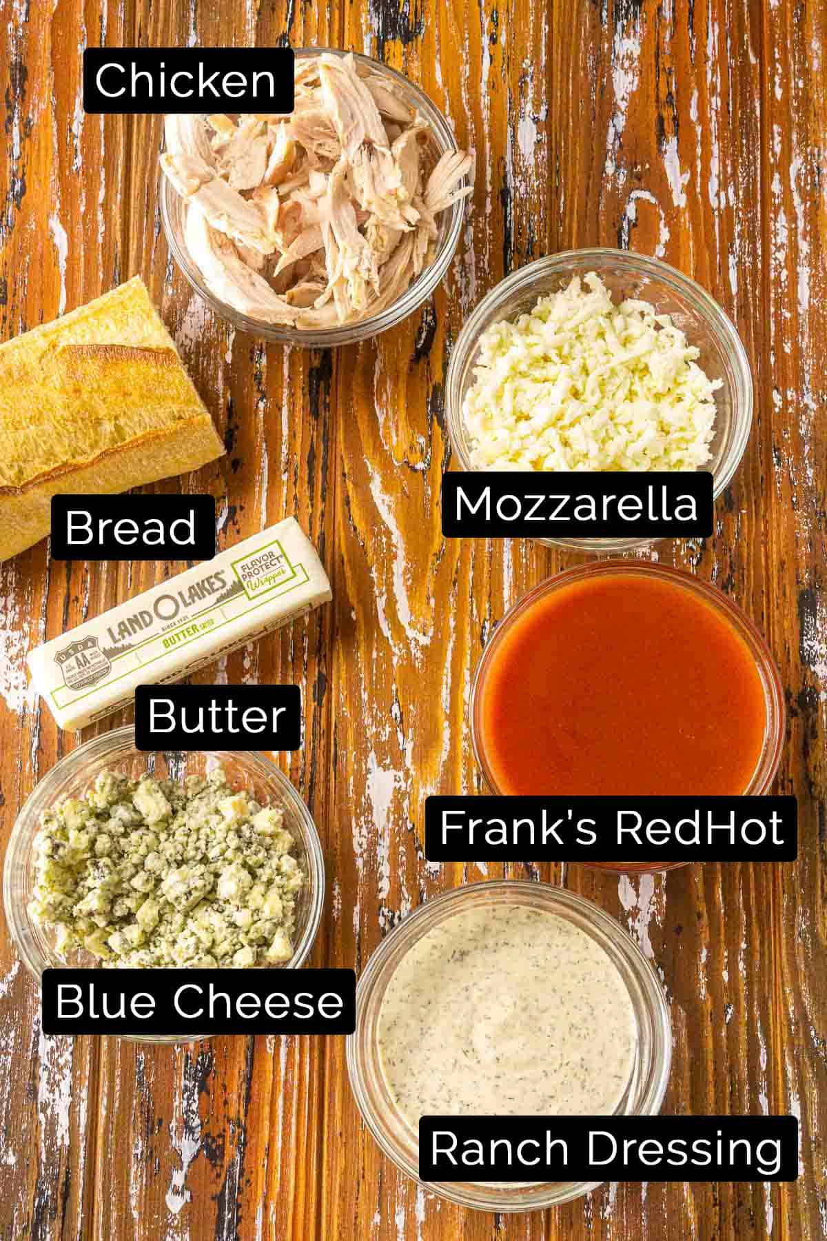 The Buffalo chicken sub ingredients with black and white labels.