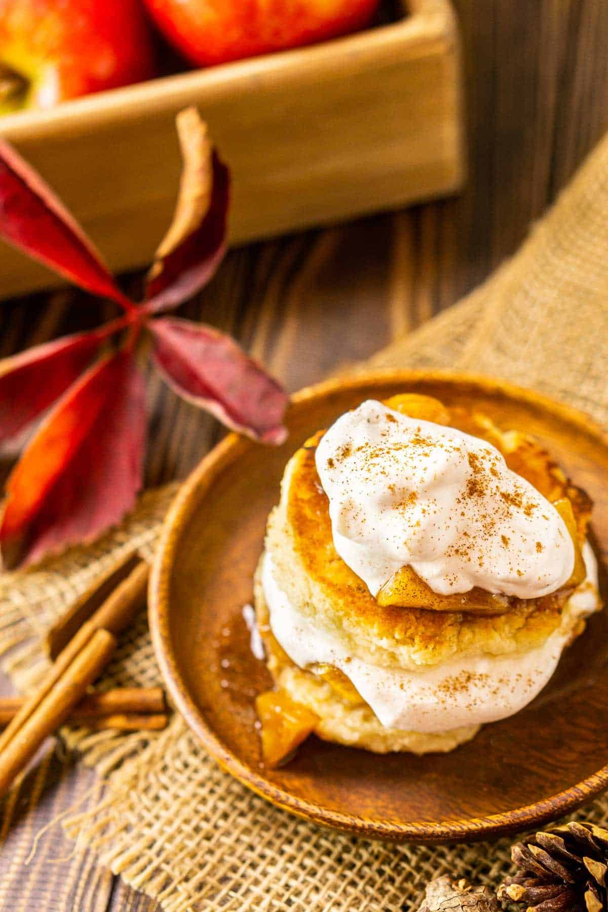 An aerial view of the apple shortcakes with a fall leaf to the side.