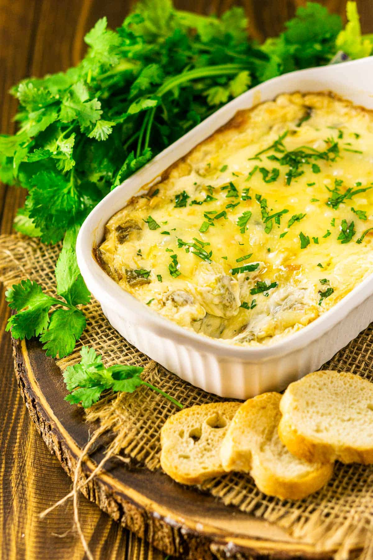 The green chile dip after bread dipped into a corner of the dish.